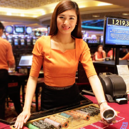 A casino dealer at Resorts World Manila