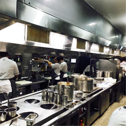 Chefs at work while working with AOM Air and Odor Management Kitchen Hood